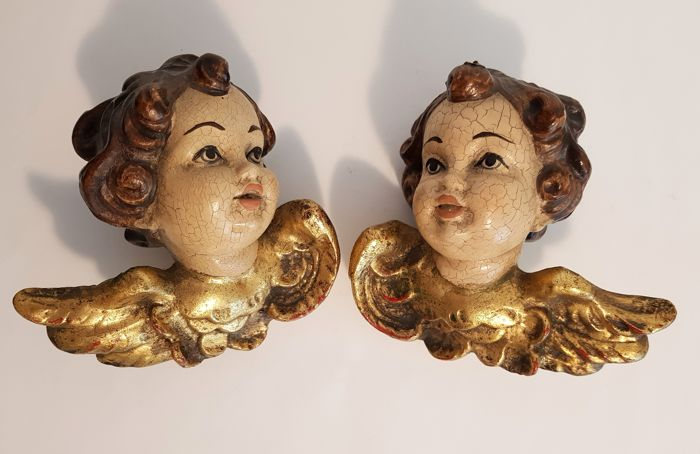 2 wooden angel/putto head figures, approx. 13 x 14 cm