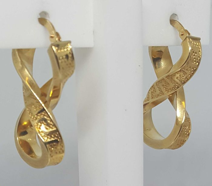 Hoop earrings matte and shine of 32 mm in gold 18 kt