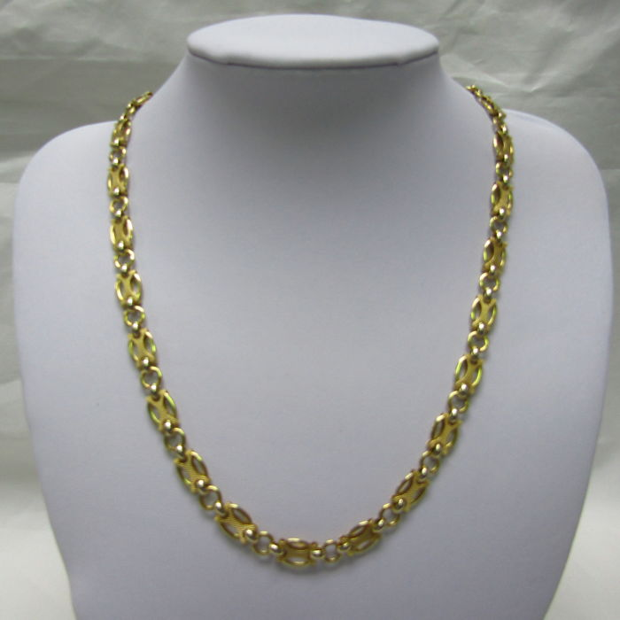 18 kt Italian design in 18 kt bicolour gold Length: 47 cm Weight: 18.5 g