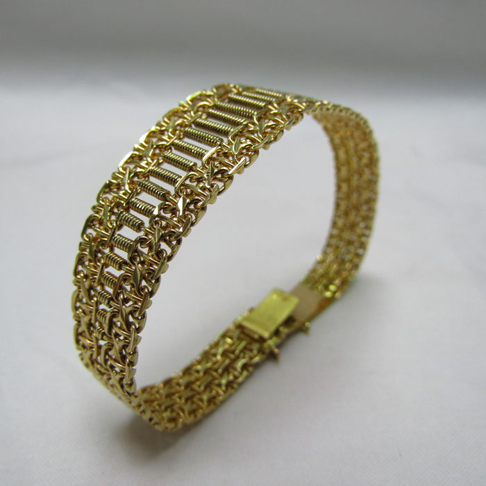 18 kt. Yellow gold - Articulated Bracelet and Draft in decrease. 20 Gr.