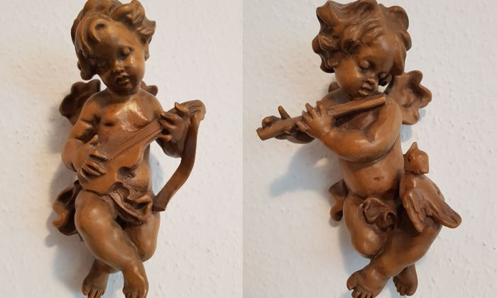 Lot of 2 wooden angel/putto figures, approx. 23 cm