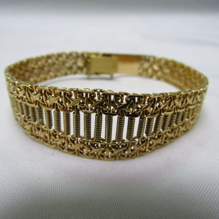 18 kt. - Articulated Bracelet and Draft in decrease. 20 Gr.