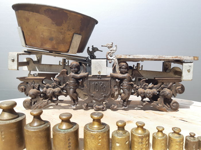 Cast iron balance scale decorated with cherubs catawiki