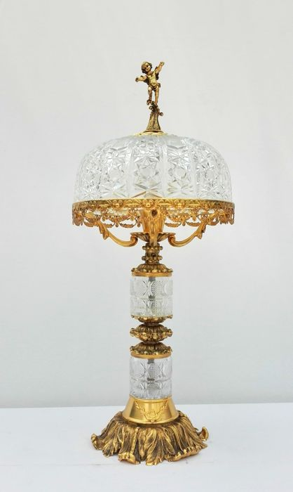 Crystal table lamp with copper ornaments and crowning of a putto - mid 20th century