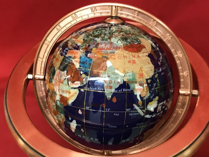 Exclusive globe in semiprecious hard stones and golden metal
