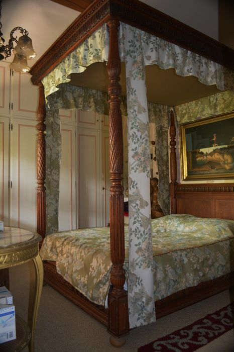 A four-poster oak bed in Renaissance style, end of 19th century