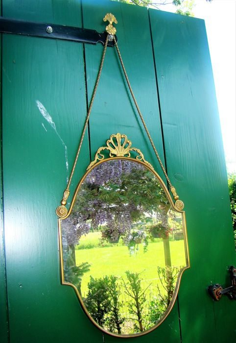 rare brass bow mirror with copper hanging cord
