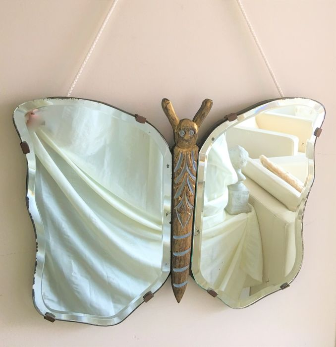 A large vintage rare facet cut mirror, unica, verso dated 18 November 1947, shaped like a butterfly in polychrome oak