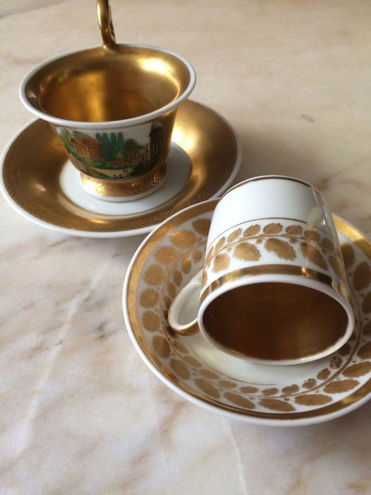 Two Empire cups and saucers with gold decor, 19th century