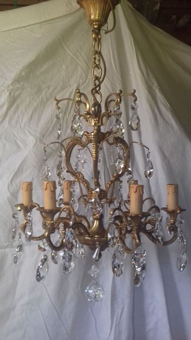 Chandelier in gilded bronze with tassels