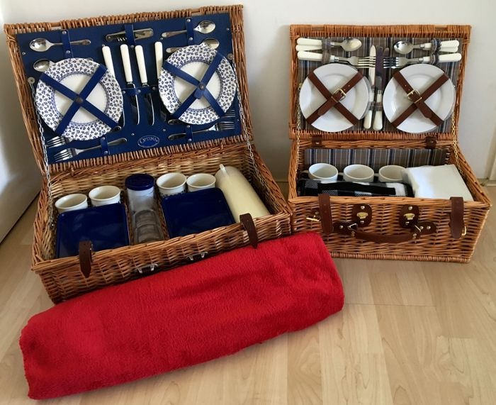 Two nostalgic wicker picnic baskets with contents