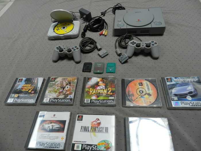 2 playstation one consoles + 9 games + 3 memory card + 2 controllers + cables