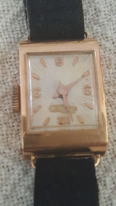 Vintage 1960s watch with case in 18 kt yellow gold and coeval leather strap