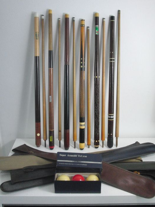 Lot of six pool cues in Holdall - Brands such as Ambassador, Thissen, Olympia & 3 billiard balls