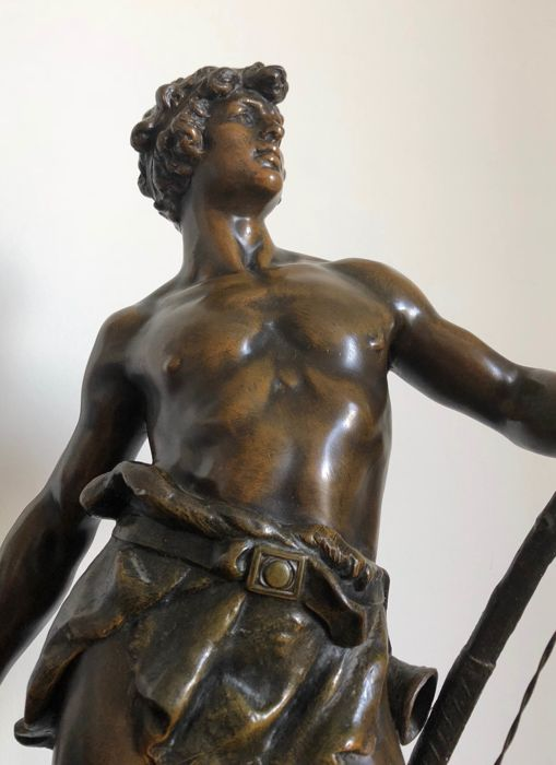 "Attributed to Louis Moreau (1855 -1919) - ""Retour de chasse"" - a large and well detailed spelter statue of an Adonis returning from the hunt - France - early 20th century"