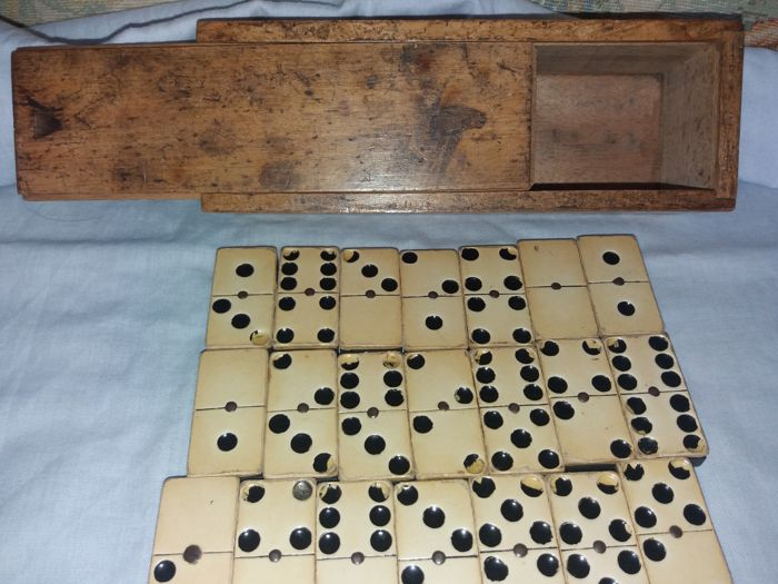 Old ebony dominoes with 28 pieces - the wooden box has a sliding drawer - the pieces are made of ebony wood and also is the clear part on top - mid-20th century