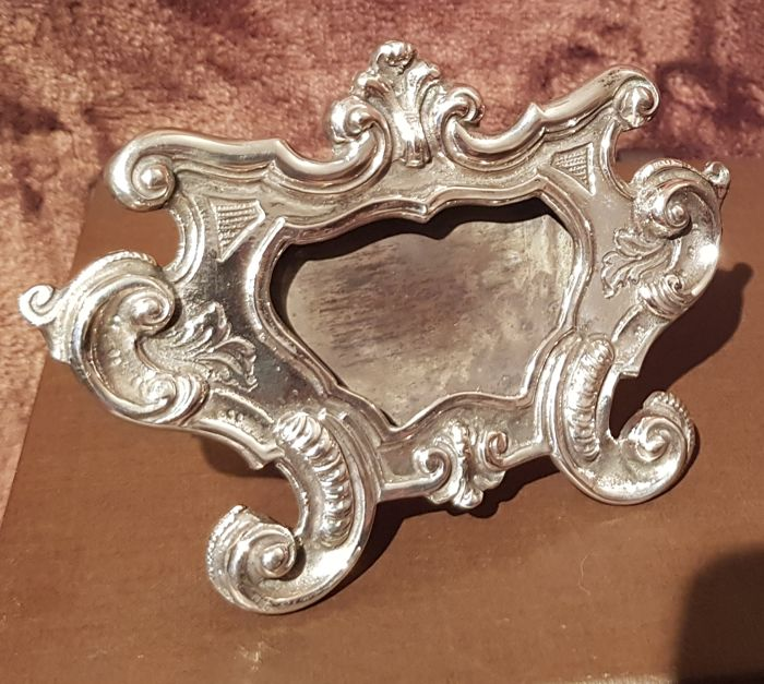 Small silver frame decorated with rocaille motifs, Italy 1900