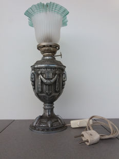 Old oil lamp in metal alloy and frosted lamp shade