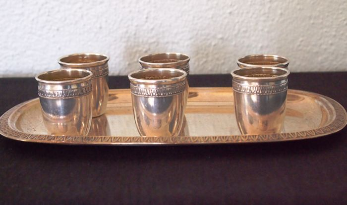 Six liqueur cups with tray