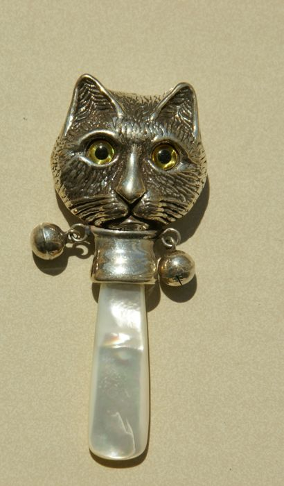 beautiful silver rattle with cats head and two bells