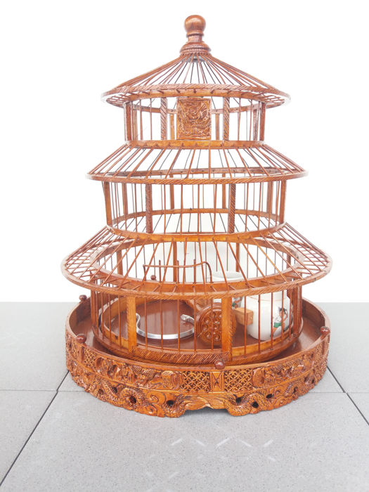 Pagoda shaped birdcage in hand carved exotic wood - 41cm high (dragon, birds of paradise, cherry blossoms,...)  - signed by artist