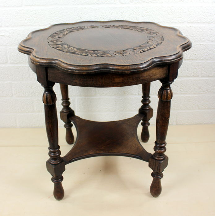Round side table with level and hand-carved engravings