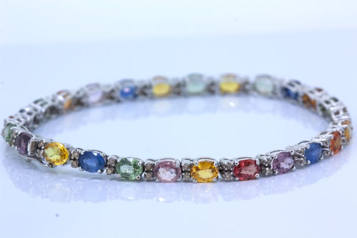 Gold tennis bracelet with tourmalines and diamonds of 1.04 ct