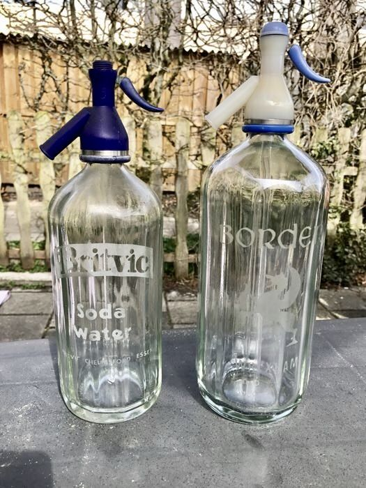 Two etched syphons / spray bottles marked Britvic and Border, ca. 1950