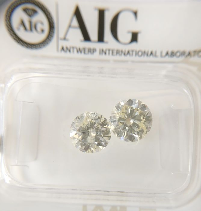 Couple of 2 Round cut diamonds total 1.83 ct J SI2