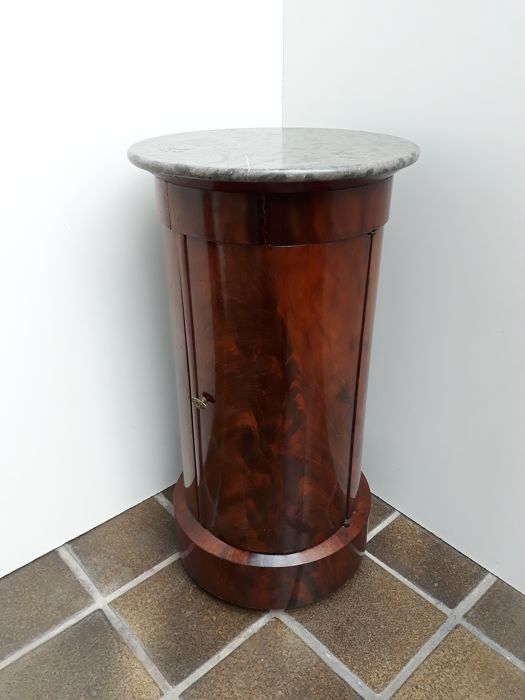 An Empire mahogany Somno with black marble top, France, circa 1820