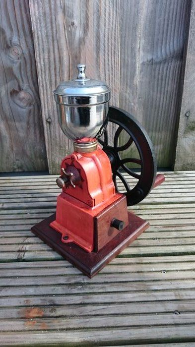 Beautiful large coffee mill with a cast iron turning wheel