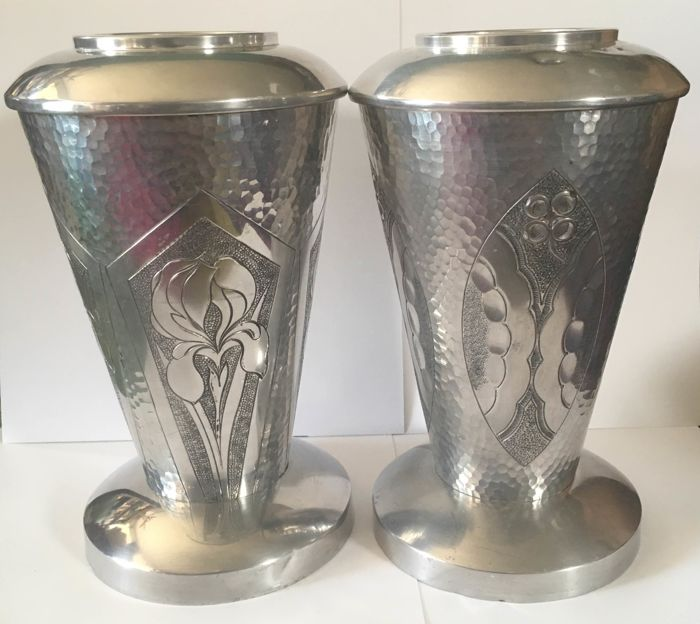 A pair of Art Deco vases made of white metal
