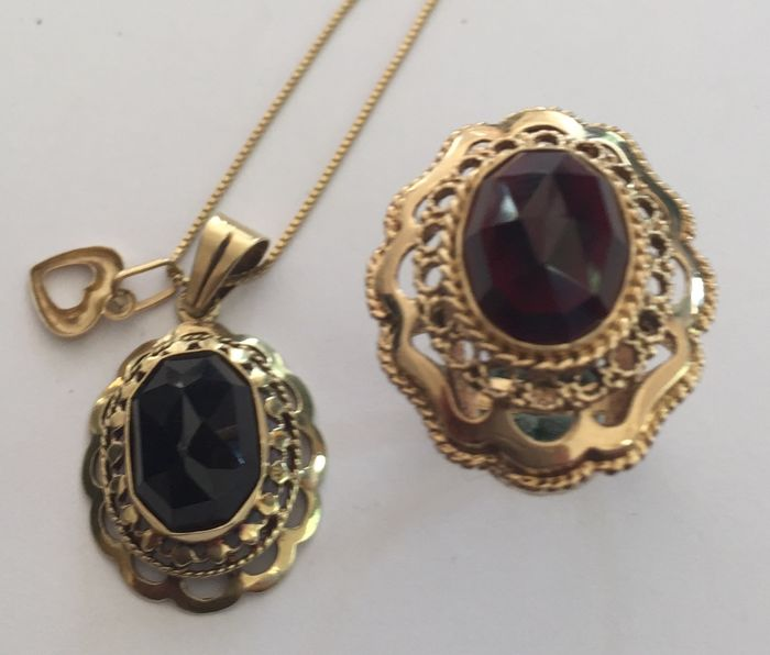 Gold garnet ring with a gold garnet pendant with necklace