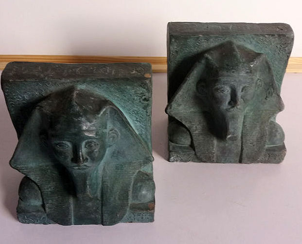 Two special handmade bookends of terracotta with green patina with images of pharaohs