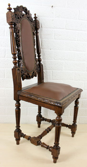 An oak chair with leather upholstery - France - 1st half 20th century