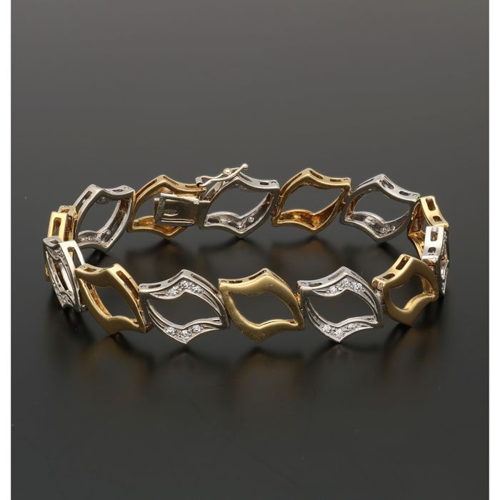 18 kt - Bicolour link bracelet set with 42 brilliant cut diamonds of approx. 0.42 ct in total - Length: 17.8 cm