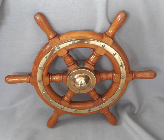 Mahogany steering wheel with brass mounts