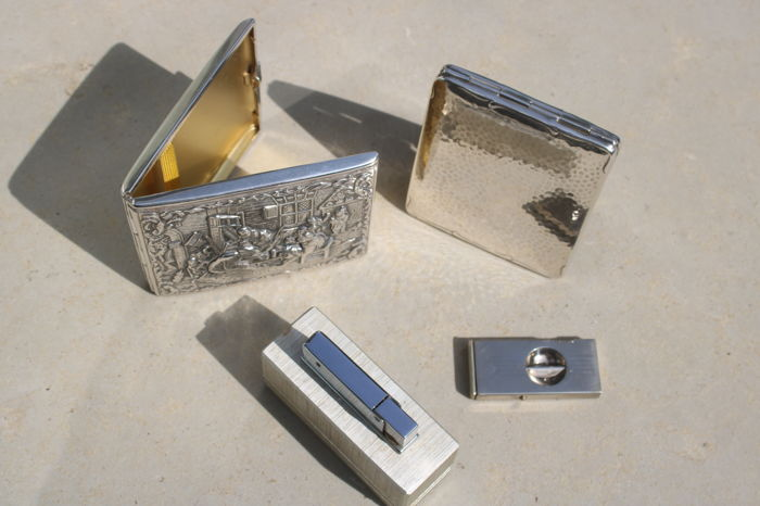 Two silver cigarette boxes with lighter and cigar cutter