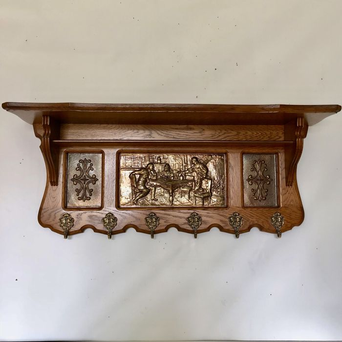 Antique oak coat rack with brass images in relief with six hooks