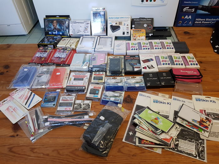 Nintendo Ds Lite boxed with Big Lot of Nintendo DS, DS Lite, DSi XL & 3DS merchandise, accesories