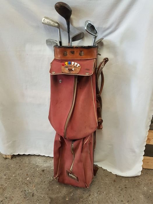 Vintage canvas golf bag with 4 autographed irons, putter and a wooden driver