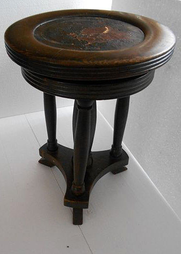 Used old piano stool for auction