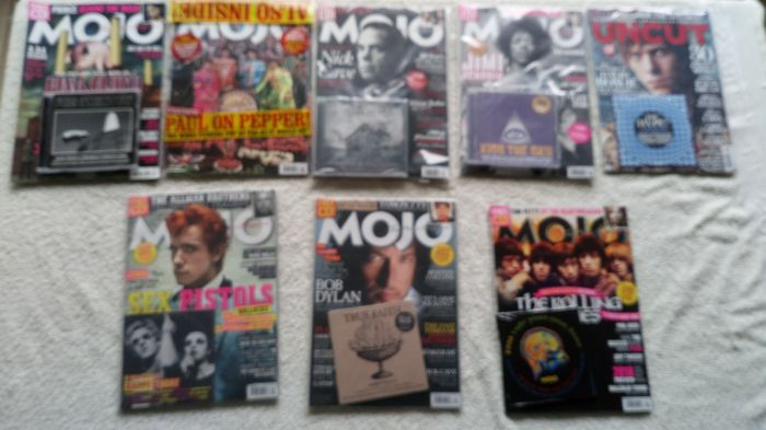 A very nice lot of 8 Mojo magazines with exclusive CD's by Pink Floyd, the Beatles, Nick Cave, Jimi Hendrix, Bob Dylan and many more.