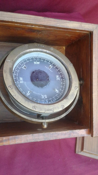 Old magnetic boat compass with box, from a large fishing boat in disarmament