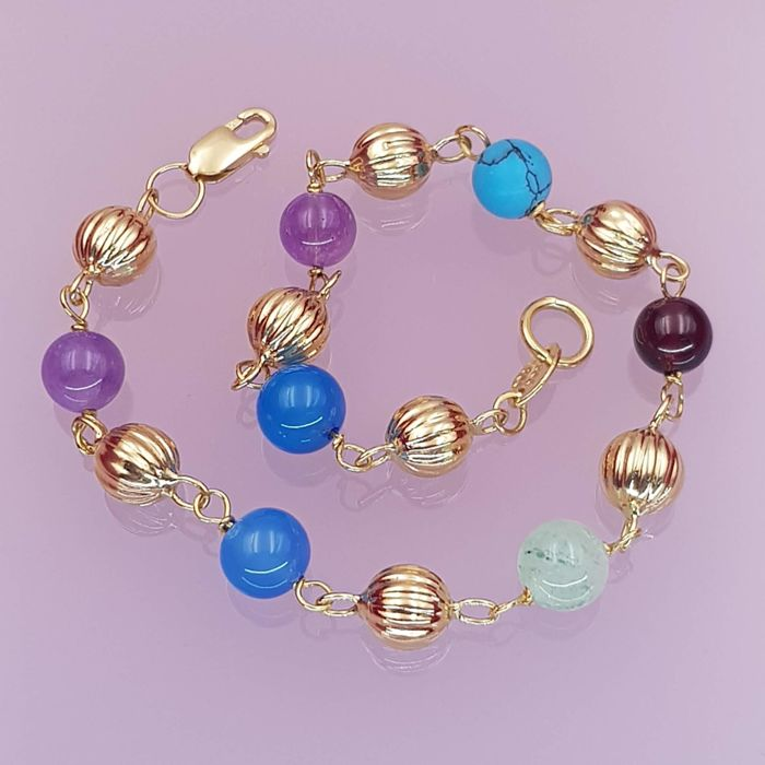 18 kt yellow gold bracelet with 7 different gemstones (amethysts, aventurine, agates, turquoise and garnet) Length: 19.50 cm