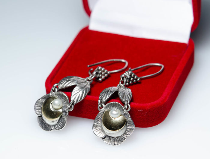 Antique earrings with pearls made of silver and gold