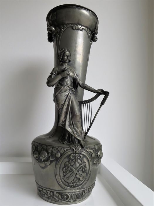 Large tin vase with female harp-player