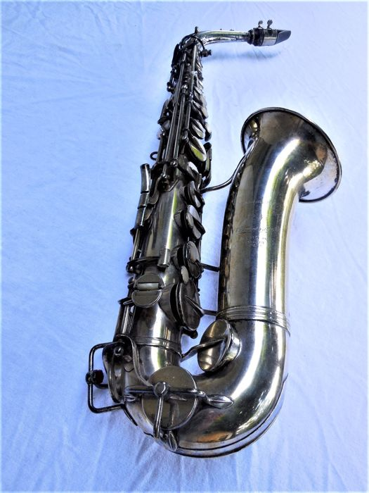 Old silver-plated saxophone, marked E. Beaugnier et C Mantes Paris
