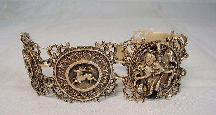 Heavy, signed silver bracelet consisting of four large medallions with depictions of animals