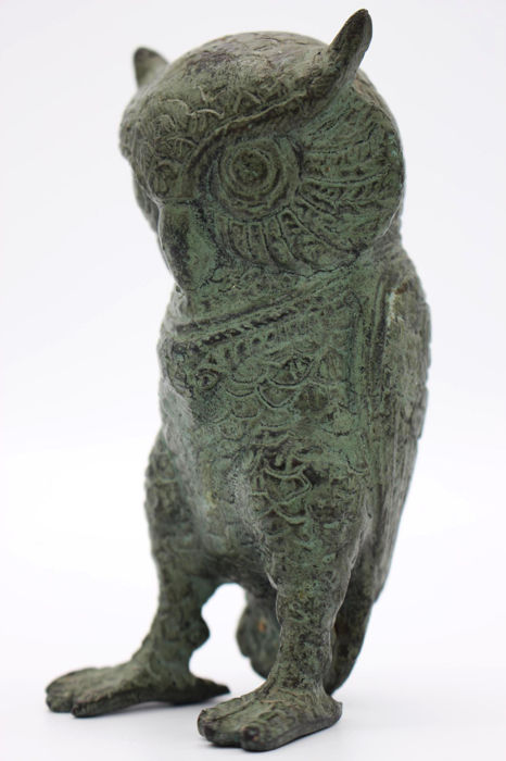 Vintage bronze owl as paperweight